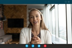 Computer application head shot display view smiling young blonde 30s woman talking looking at web camera, successful businesswoman holding online video call negotiations meeting with partners.