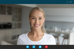Computer application screen headshot view smiling 30s blonde woman looking at web camera, enjoying pleasant conversation talk by video call with friends or communicating with colleagues at home.
