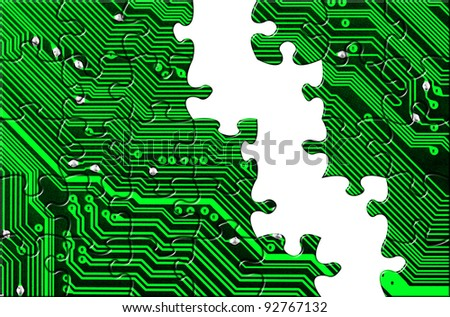 Computer board made of puzzle - technology concept background