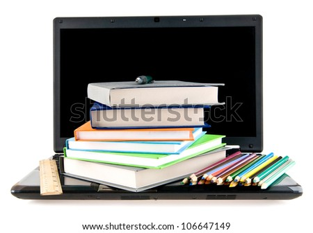 computer, books and pencils on a white background