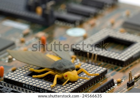 computer bug concept - bug on a motherboard