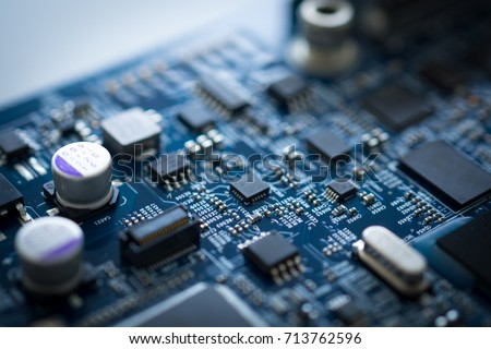 Computer chip circuit board motherboard background. CPU processor electronic core technology hardware digital blue.