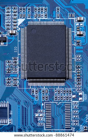 Computer chip on the blue motherboard. Copy space on chip.