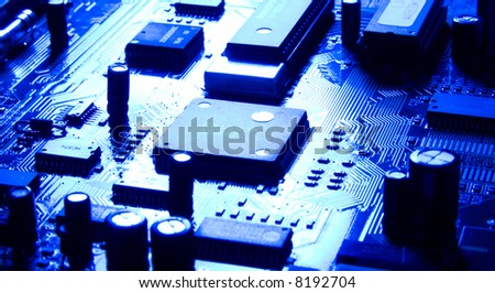 Computer chip with bright reflecting light and blue tint.