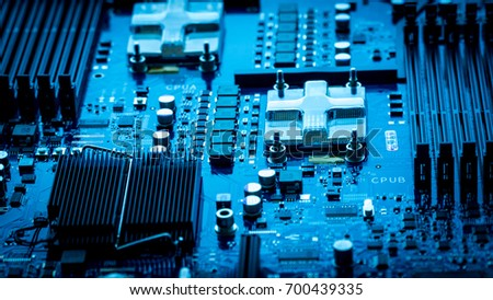 computer circuit board background. blue chip cpu core texture technology with processors microelectronics hardware concept electronic device motherboard #700439335