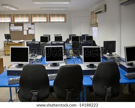 Computer classroom with plenty desktops and TFT screens