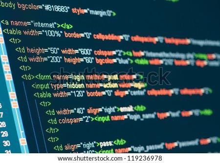 Computer Code HTML on monitor - stock photo