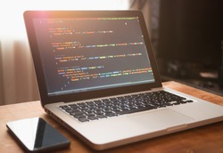 Computer code on laptop (web developing)