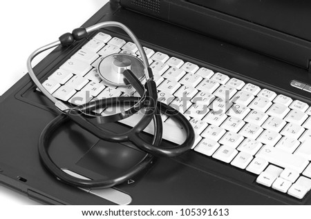 computer concept with stethoscope on laptop, shallow dof