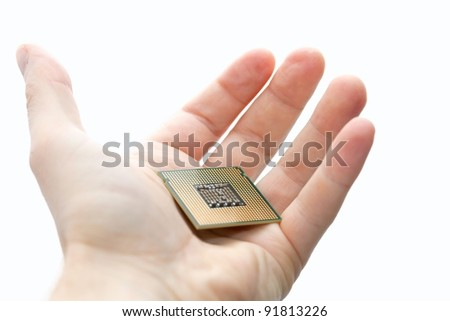 Computer CPU in human hand i