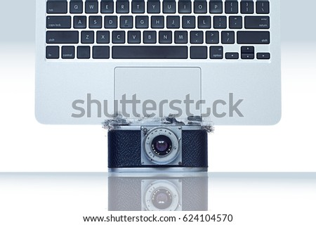 Computer crash over a vintage photo camera. Abstract art image. Background for business in digital photography