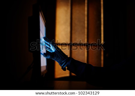computer crime with hacker hand, selective focus on nearest part