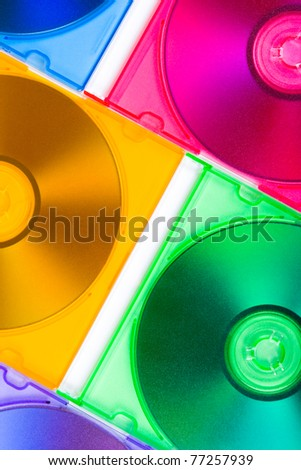 Computer disks in multiciolored boxes - technology background