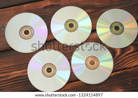 Computer disks on a wooden background