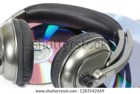 Photo of  computer dj headphone plastic in CD stack isolated on white background