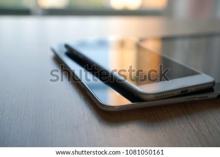 Computer Electronic Devices laptop keyboard, tablet and modern smart phone on white table, communicator technology background business concept digital service or support and network online closeup #1081050161
