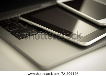 Computer Electronic Devices laptop keyboard, tablet and modern smart phone on white table, communicator technology background concept digital service or support and network online close up top view - Shutterstock ID 721901149