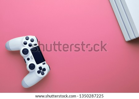Computer gaming. Gaming concept. White joystick and conor of gamepad console on pink background. #1350287225