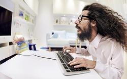 Computer geek portrait with keyboard and eyeglasses