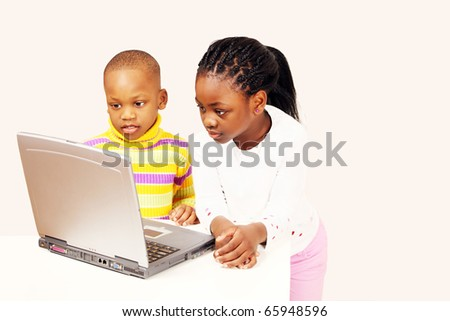 Computer generation kids on laptop