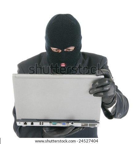 Computer hacker - criminal with the laptop computer
