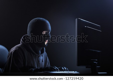 Computer hacker - Male thief stealing data from computer