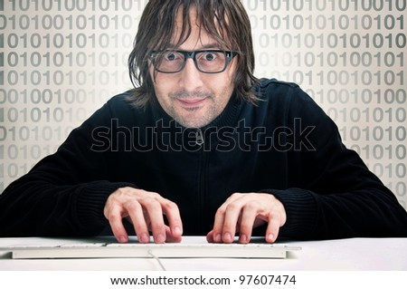 Computer hacker. Man is typing on computer keyboard. - stock photo
