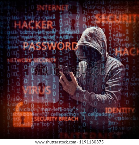 Computer hacker with mobile phone smartphone stealing data #1191130375