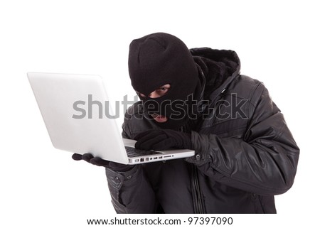 Computer hacker with white laptop