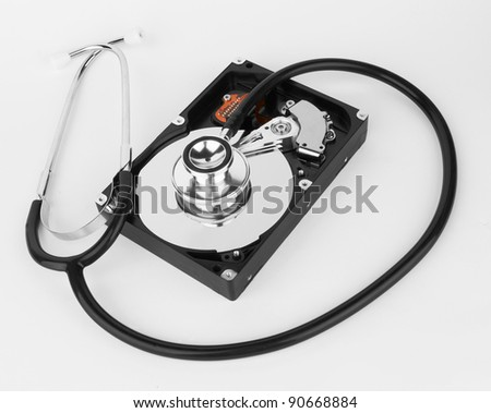 Computer hard drive and a stethoscope, on white background