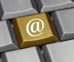 Computer key golden- email symbol