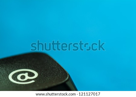 Computer key with e-mail icon against a blue background
