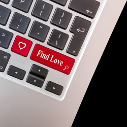 Computer key with love shape and the words find love.