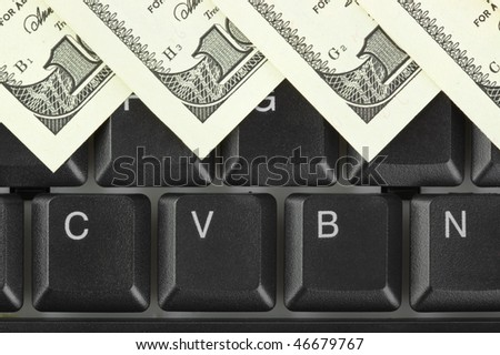 Computer keyboard and money - concept business background