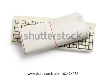 Computer Keyboard and Newspaper roll with white background