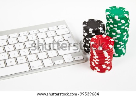 computer keyboard and poker chips