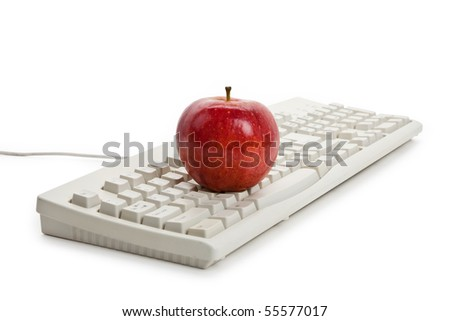Computer Keyboard and red apple close up