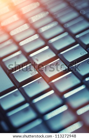 Computer keyboard background. Shallow DOF.