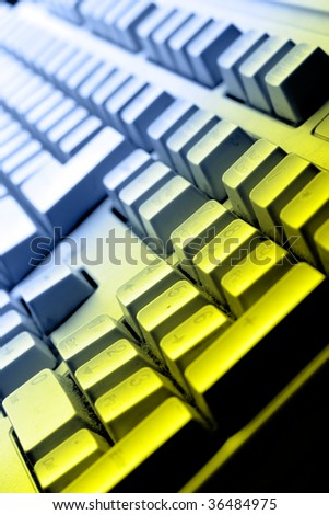Computer keyboard close up in colorful light