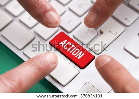 Computer Keyboard Concept: Many fingers pushing red ACTION keyboard button