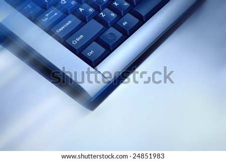 Computer keyboard in blue light.