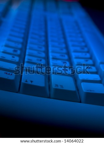 Computer keyboard in blue light perspective wide angle