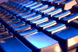 Computer Keyboard with blue and orange lighting