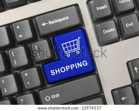 Computer keyboard with blue shopping key, internet concept
