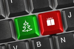 Computer keyboard with Christmas keys - holiday concept