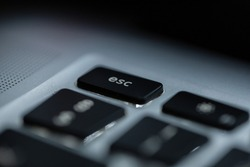 Computer keyboard with focus on the ESC button, macro. Exit concept