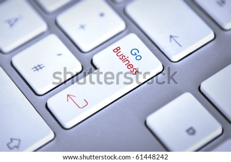 "computer keyboard with ""go business"" return key"
