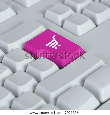 Computer keyboard with on-line shopping symbol on it