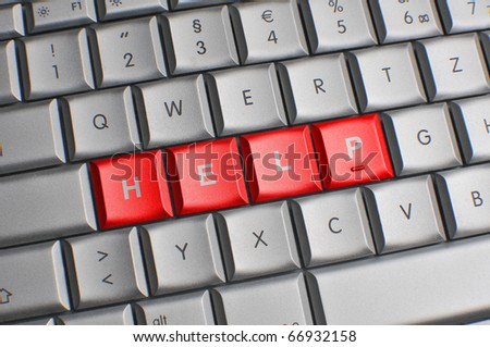 Computer keyboard with red help keys