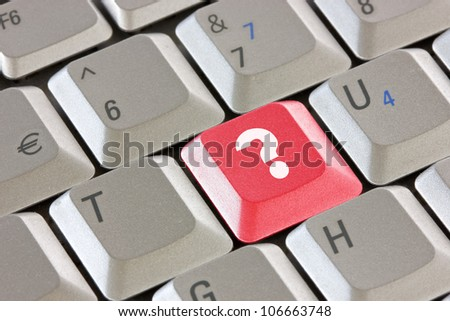 Computer keyboard with red question key - business concept